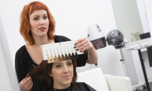 hair colorists helping client choose color